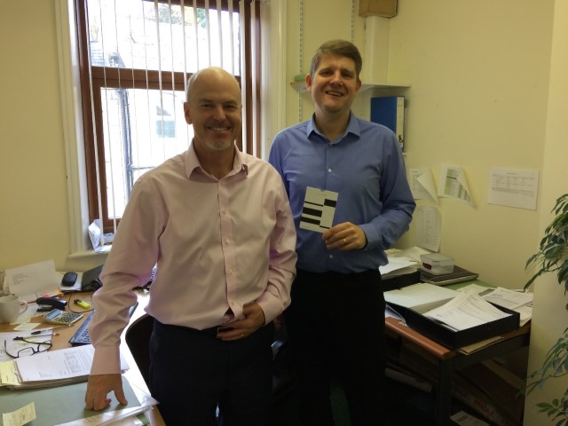 Happy winner Alan Comeford (right) and Tony Short, one of the partners at Little & Georgiou.